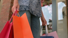 Woman walking with shopping bags stock footage