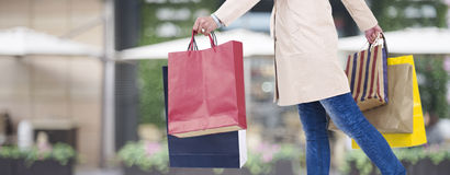 Woman walking with shopping bags Royalty Free Stock Images