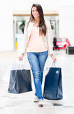 Woman walking at the shopping center Stock Image