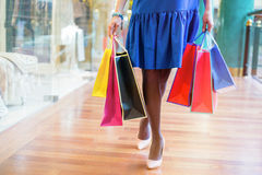 Woman walking at the shopping center with bags Royalty Free Stock Images