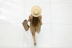 Woman walking in shopping centre. Back view from above Royalty Free Stock Image