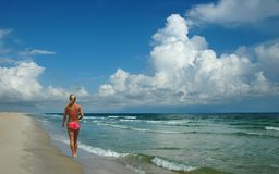 Woman walking on Shore Stock Photography