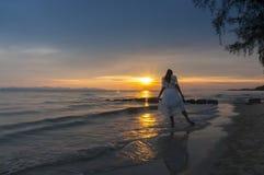 Woman walking at shore alone Royalty Free Stock Photos