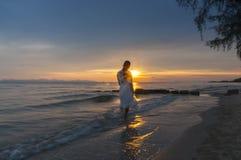 Woman walking at shore alone Royalty Free Stock Photography