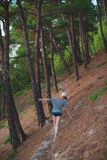 Woman walking in  shorts the summer forest Royalty Free Stock Photography