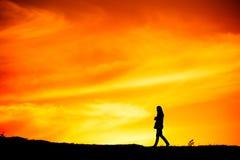 Woman walking, silhouette Royalty Free Stock Photos