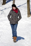 Woman walking in snow Stock Photo
