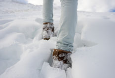 Woman is walking in snow Stock Photos