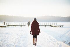 Woman walking in snowy landscape Stock Photography