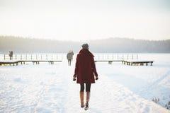 Woman walking in snowy landscape stock photography
