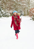 Woman Walking Through Snowy Woodland Royalty Free Stock Image