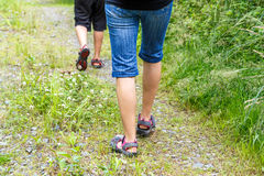 Woman walking with son cross country Royalty Free Stock Images