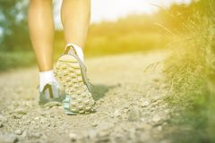 Woman walking insports shoes, sport and fitness outdoors. Woman walking in sport or hiking shoes. Jogging, trekking or training outside in summer nature stock photos