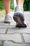 Woman walking, sport running shoes Stock Image