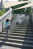 Woman Walking Stairs with Eco Art Stock Images