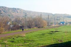 A woman walking from the station in her village stock photo
