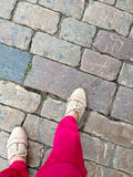 Woman walking on stone pavement Royalty Free Stock Photo