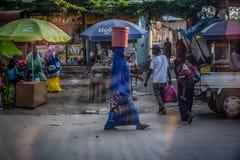 Woman walking through Stone Town, Zanzibar. royalty free stock photography