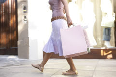 Woman Walking by Store Stock Image