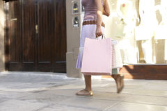 Woman Walking by Store Royalty Free Stock Photography