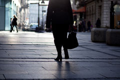 Woman walking in the street Royalty Free Stock Image