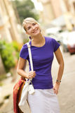 Woman walking on the street Royalty Free Stock Photography
