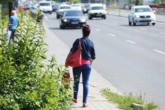 Woman walking on the street Royalty Free Stock Photos