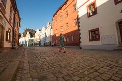 Woman walking on the street in Cesky Krumlov Royalty Free Stock Image