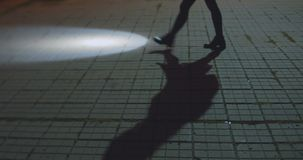 Woman is walking at street with flashlight