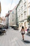 Woman walking on street in Graz Royalty Free Stock Images