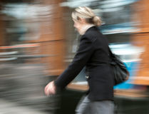 Woman  walking in the street Royalty Free Stock Photo