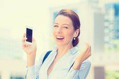 Woman walking on street listening music on mobile smart phone Royalty Free Stock Photo