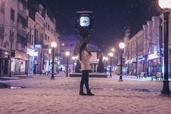 Woman Walking on Street Near Light Post during Winter Season royalty free stock images