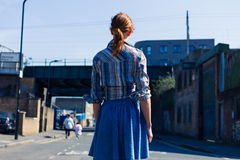 Woman walking in the street near trainline Royalty Free Stock Photography