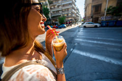 Woman walking on the street with take away coffee Royalty Free Stock Photos