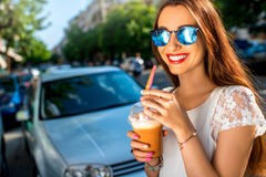 Woman walking on the street with take away coffee Royalty Free Stock Photo