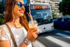 Woman walking on the street with take away coffee Stock Photos