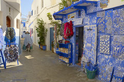 Woman walking on the streets of Asilah Royalty Free Stock Image