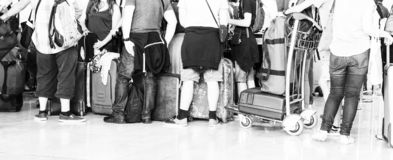 Woman walking suitcase luggage bag on trolley in the airport. Black and white picture royalty free stock photos