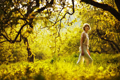 Woman walking in summer apple orchard Stock Photo