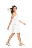 Woman walking in summer dress Stock Images