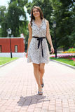 Woman walking on the summer park Stock Photo