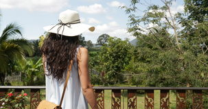 Woman Walking On Summer Terrace Back Rear View Of Young Girl Looking On Beautiful Tropical Landscape From Hotel Balcony. Slow Motion 60 stock video footage