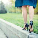 Woman is walking on a sunny day Royalty Free Stock Images