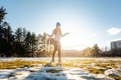 Woman walking thru slushy snow royalty free stock images