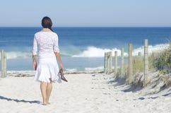 Free Woman Walking To Beach At Ocean Stock Photos - 27247703