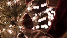 Woman walking to decorate on Christmas tree with bokeh lights.  stock video footage