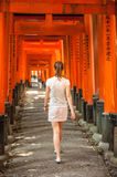 Woman walking through Torii Gates near Kyoto, Japan Royalty Free Stock Images