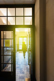 Woman walking toward door. Elegant woman wearing French coat walking toward the door of a luxury French building - concept for business success, new beginnings stock photography