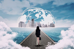 Woman walking toward the global business royalty free stock image